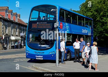 Bus and passengers, Thornton-le-Dale, North Yorkshire, England UK - Stock Image