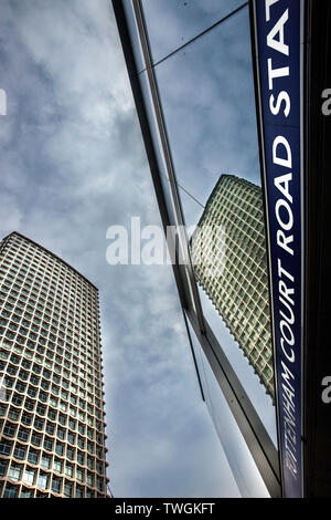 Centre point tower reflected in tottenham court road tube station signage. - Stock Image