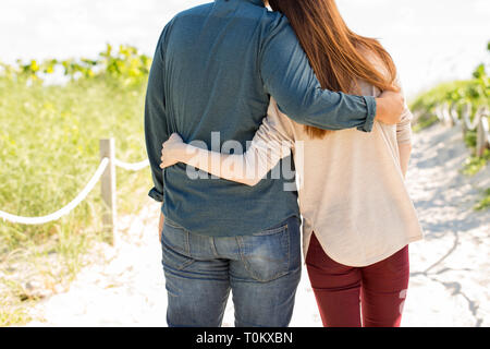 Young happy couple hugging at the beach. - Stock Image