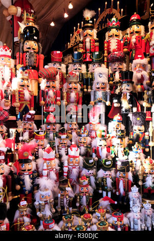A display of wooden Christmas toy nutcracker soldiers in a stall at a city center German Market on a UK High st - Stock Image