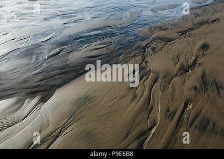Detail of beach sand and patterns at low tide, Arcadia Beach State Park, Oregon - Stock Image