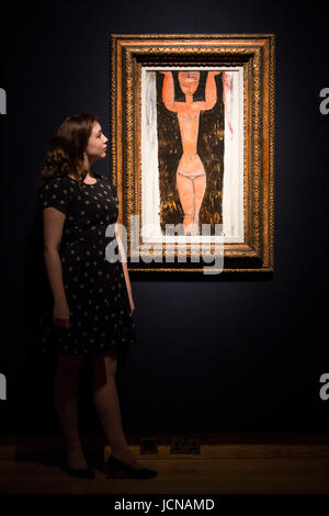 London, UK. 16 June 2017. A Christie's employee looks at the painting Cariatide, 1913, by Amedeo Modigliani, - Stock Image