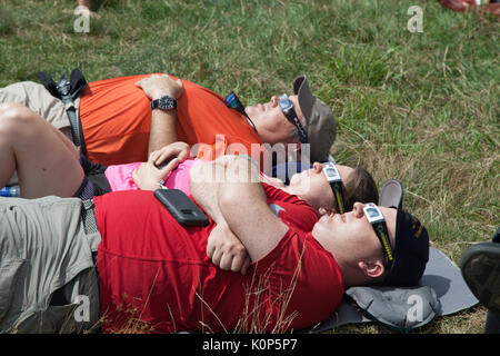 Whigg Meadow, TN, USA - August 21, 2017: A group of friends watch the beginnings of the eclipse in the path of totality at Whigg Meadow, Cherohala Sky - Stock Image
