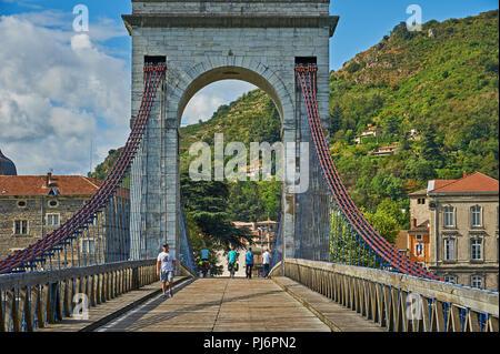The historic suspension bridge built by Marc Seguin across the River Rhone linking Tournon sur Rhone, Ardeche  and Tain L'Hermitage, Drome. France. - Stock Image