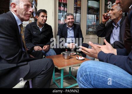 Kurdish men at local restaurant  in Hasankeyf , Turkey - Stock Image