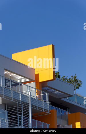 Bright yellow decorative panel on the roof of a newly constructed residential building in Vancouver, BC, Canada - Stock Image
