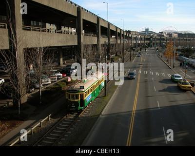Street car makes it's way along side the Alaskan Way Viaduct in Seattle, Wa. 2004 - Stock Image