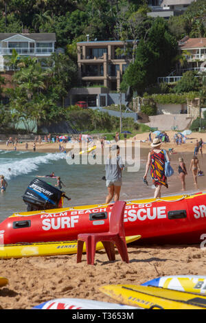 Surf rescue lifeguard equipment including dinghy with outboard and surfboards on Palm beach,Sydney,Australia - Stock Image