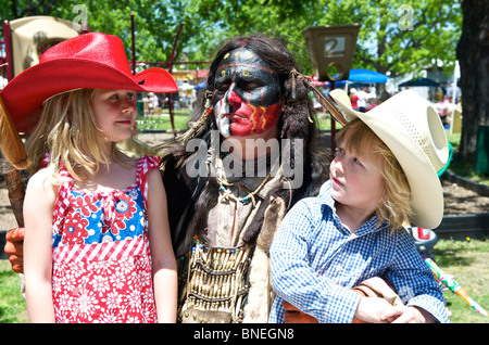 Native American actor with two children at small town fair Bridgeport, Texas, USA - Stock Image