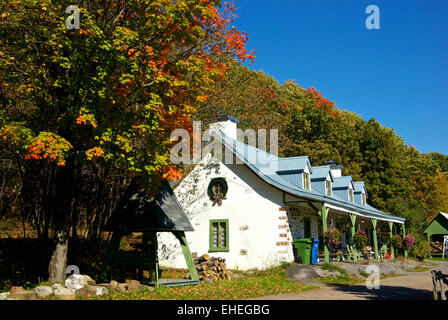 Early Quebec settler family Cloutier plaster over stone ancestral farmhouse Chateau Richer - Stock Image