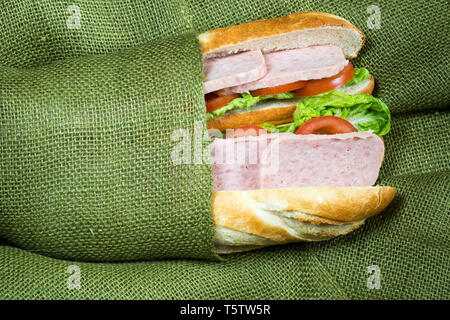 Sandwich  wrapped in cloth - Stock Image