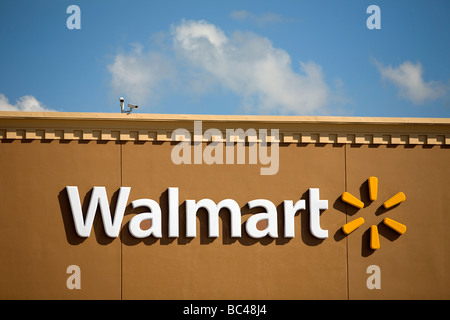 The front of a Walmart Supercenter in Rogers Ark displaying Wal Mart Stores Inc's new logo. - Stock Image