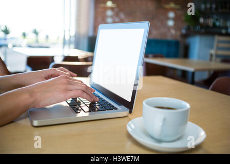 Hand using a laptop - Stock Image