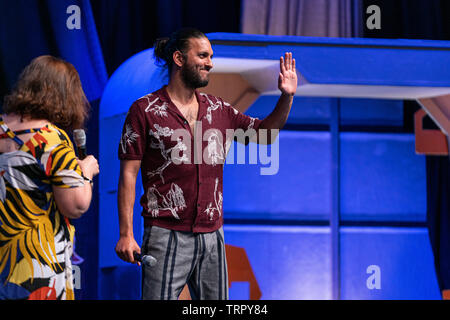 Bonn, Germany - June 8 2019: Shazad Latif (*1988, British actor - Star Trek: Discovery) entering the panel at FedCon 28, a four day sci-fi convention. FedCon 28 took place Jun 7-10 2019. - Stock Image