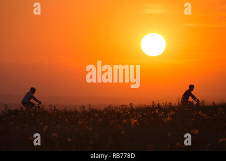 Woman and man riding bicycle on Nose Hill - Stock Image
