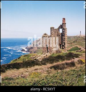 Engine house, Wheal Edward Mine, Botallack, St Just, Cornwall, 1967-1970. View of the abandoned engine house on the Atlantic cliffs. - Stock Image