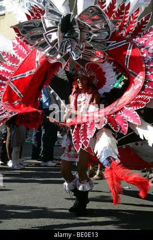 Red Indian Carnival Girl in the Notting Hill Carnival Parade 2009 - Stock Image