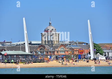 People at Southend on Sea seaside family beach dome of famous Victorian Kursaal amusement park beside River Thames Estuary Southend Essex England UK - Stock Image