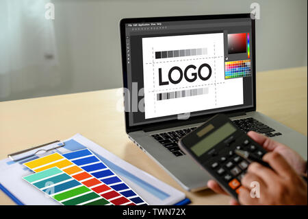 Creative Designer Graphic at work. , Illustrator Graphic designer working digital tablet and computer Color swatch samples - Stock Image