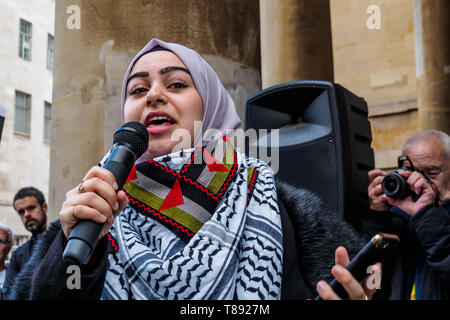 London, UK. 11th May 2019. A young Palestinian woman speaks before thousands march from the BBC to a rally in Whitehall a few days before Nakba day showing solidarity with the Palestinian people and opposing continued Israel violation of international law and human rights. The protest called for an end to Israeli oppression and the siege of Gaza and for a just peace that recognises Palestinian rights including the right of return. It urged everyone to boycott and divest from Israel and donate to medical aid for Palestine. Peter Marshall/Alamy Live News Credit: Peter Marshall/Alamy Live News - Stock Image