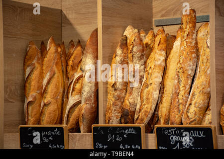 Freshly baked traditional baguettes and bread in small rustic bakery in Provence, South of France, close up - Stock Image