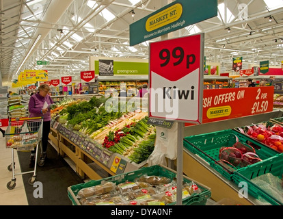 fresh vegetables on offer at Market St section of Morrisons supermarket on the edge of Hadleigh Suffolk - Stock Image