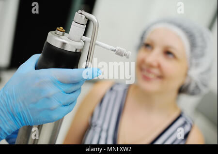 Doctor makes the patient Cryomassage - Stock Image