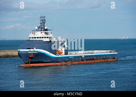 The Offshore Supply Vessel Highland Guardian approaches Aberdeen harbour from the North Sea. - Stock Image