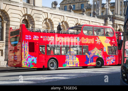 The City Sightseeing open-top tour bus in High Street, Oxford - Stock Image