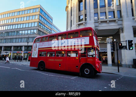 routemaster double decker bus driven in City of London, London, England, UK - Stock Image