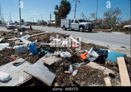 Debris litters the side of the Overseas Highway in the aftermath of Hurricane Irma September 17, 2017 in Marathon, - Stock Image
