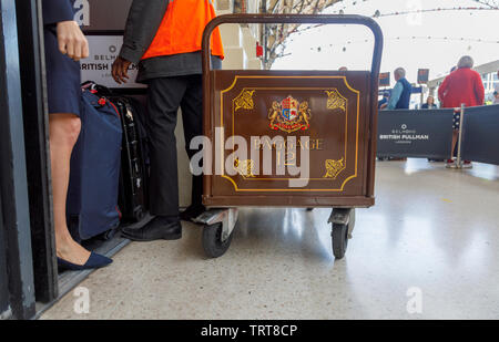 Pullman baggage luggage trolley with suitcases at the entrance to the Belmond Venice Simplon Orient Express departure lounge, London Victoria station - Stock Image