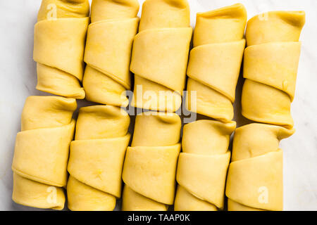 Croissants from fresh french pastry on marble table. - Stock Image