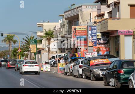Chania, Crete, Greece. June 2019. The busy seaside town main street of Kalamaki a suburb of Chania, Crete. - Stock Image