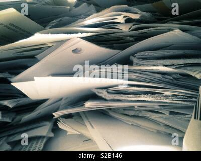 Close up of piles pf papers to be recycled - Stock Image