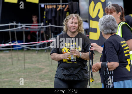 Mud runner getting her medal - Stock Image