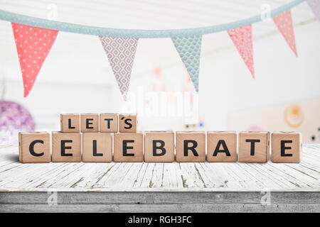 Let's celebrate birthday greeting in a bright kids room with flags hanging from the ceiling - Stock Image