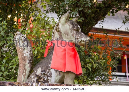 Sculpture of fox, regarded as a messenger it is often found at Shinto shrines dedicated to the god Inari, Fushimi Inari Taisha, Fukakusa YabunouchichÅ - Stock Image
