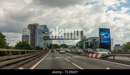 Driving into London on the M4 motorway on a cloudy day, entering the city limits. - Stock Image
