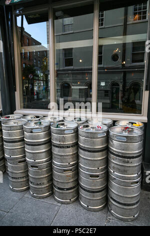 Empty Guinness Barrels Stacked outside Dublin Bar. Dublin, Ireland. - Stock Image
