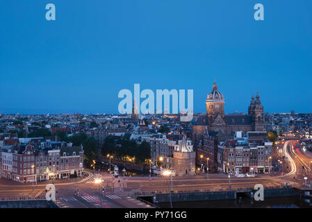 Early morning in Amsterdam, Netherlands, skyline with basilica Saint Nicholas (Nicolaaskerk) - Stock Image