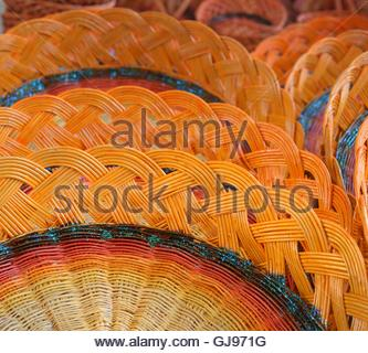 Colorful woven baskets from the branches. - Stock Image