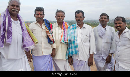 A group of south Indian local tourists men in Hampi, India. - Stock Image