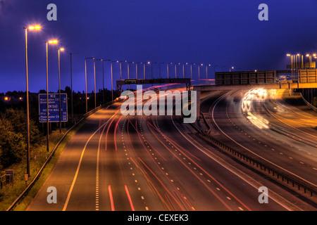 M6 Junction 21 at dusk, night shot slow exposure - Stock Image