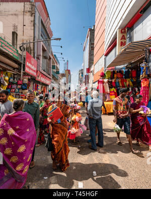 Vertical streetview of a busy shopping precinct in Chennai, India. - Stock Image