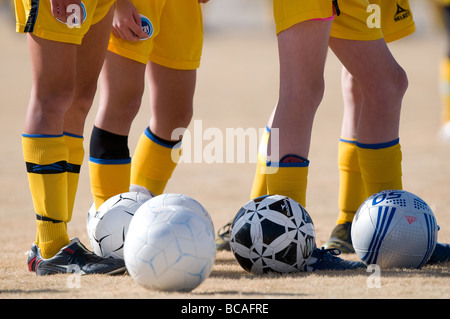 Female teenage soccer players wearing shin guards. - Stock Image