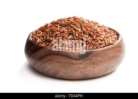 Red rice  in wooden bowl isolated on white - Stock Image