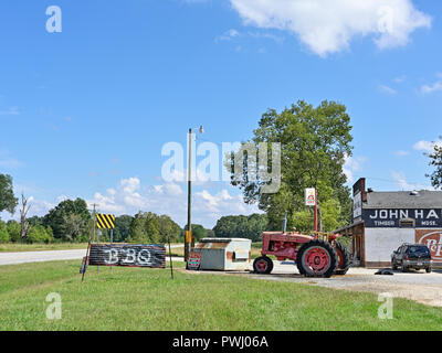 Rural Alabama BBQ or Bar-B-Que restaurant or roadside store with homemade sign by the country road in Cecil Alabama, USA. - Stock Image