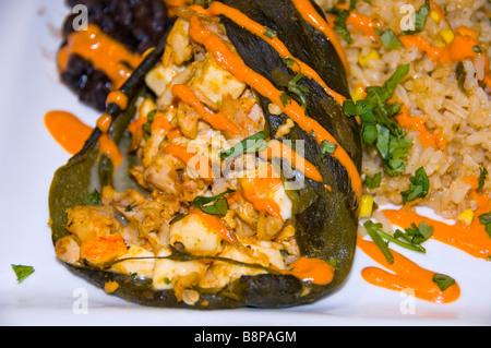 Chili chicken relleno black beans rice closeup food detail San Antonio Texas Dining Tex-Mex stuffed relleno chili - Stock Image