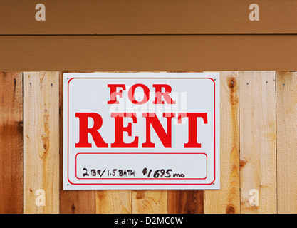 for rent sign on fence - Stock Image